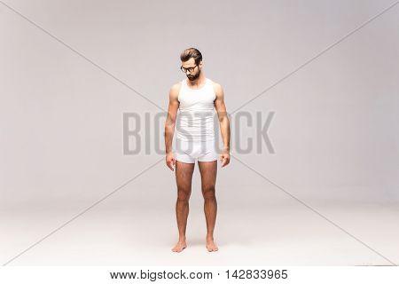 Man in underwear. Full length studio shot of handsome young man in underwear