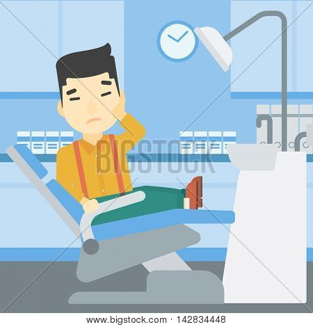 An asian young patient sitting in dental chair at dentist office. Sad man suffering from tooth pain. Man having a toothache. Vector flat design illustration. Square layout.