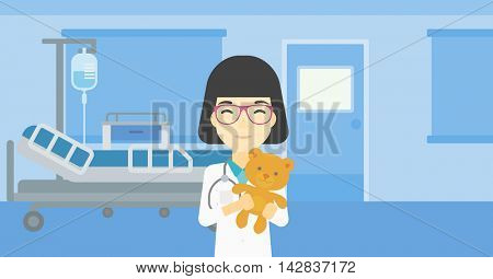 Young asian female pediatrician doctor holding a teddy bear. Professional pediatrician doctor with a teddy bear in the hospital room. Vector flat design illustration. Horizontal layout.