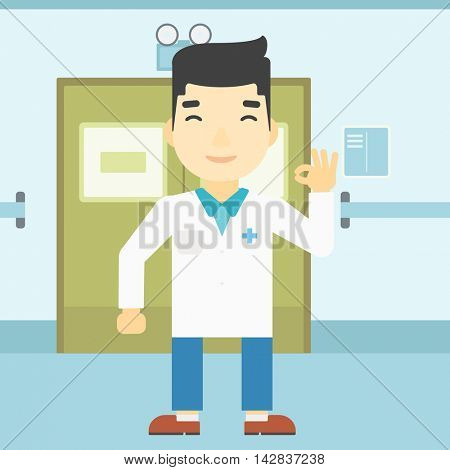 An asian doctor in medical gown showing ok sign. Smiling doctor gesturing ok sign. Doctor with ok sign gesture in the hospital corridor. Vector flat design illustration. Square layout.