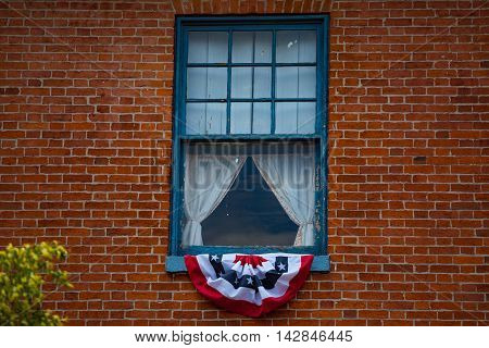 Gettysburg PA - June 30 2013: Bunting on the window at the Wills House marks the room where President Lincoln stayed.
