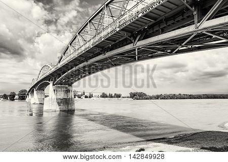 Maria Valeria bridge joins Esztergom in Hungary and Sturovo in Slovak republic across the Danube river. Architectural scene. Black and white photo. Transportation theme.