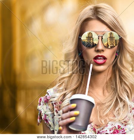 beautiful portrait of blond girl with hairstyle and sunglasses