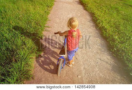 little girl riding runbike in summer, kids sport