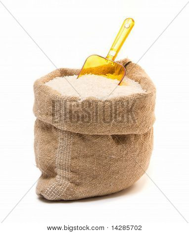 Sack Filled With Rice And Transparent Plastic Orange Scoop