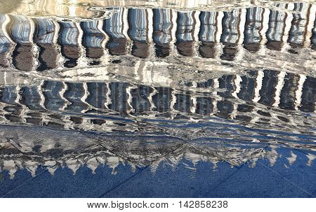 Reflection of Procuratie Vecchie in Saint Mark Square during 'Acqua Alta' (Venice high tide)