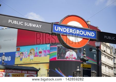 Entrance To Underground On Piccadilly Circus With Large Screen In Background