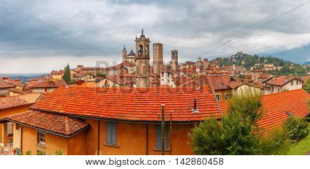 Panoramic aerial view of Medieval Upper town Citta alta of Bergamo with towers and churches in nasty cloydy day, Lombardy, Italy poster
