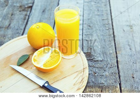 Orange Juice In Glass With Knife.