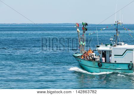 Sea Trawler Hand To Throw Bouquets Of Flowers