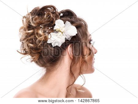 young woman bride with beautiful hairstyle and stylish hair accessory rear view. Isolated on white background.