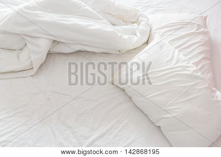 Top view of a messy bedroom with crumpled bedclothes. Bed room is not neatly arranged for new customers / guests to sleep in.