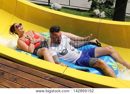18TH JULY 2016, CALIS,TURKEY; An English couple having fun on a water slide in a waterpark in Calis, in Turkey, 18th july 2016