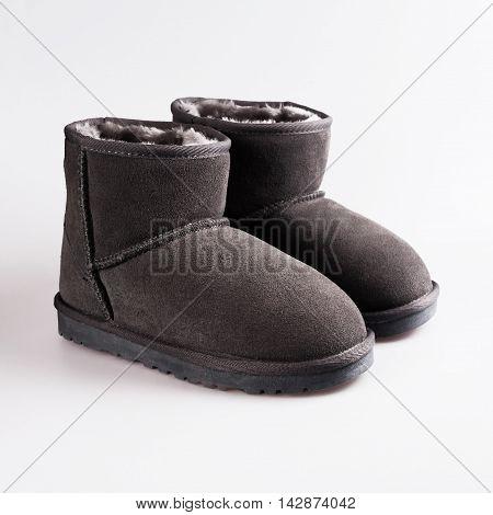 stylish female winter shoes in white background