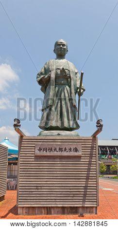 KOCHI JAPAN - JULY 19 2016: Statue of Nakaoka Shintaro near Kochi railway station Japan. Nakaoka Shintaro (1838-1867) was an associate of Sakamoto Ryoma in anti-shogun movement of Bakumatsu period