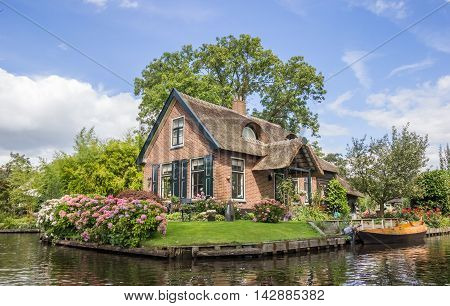 House and garden at the central canal of Giethoorn Holland