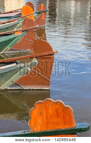 Rudders of traditional wooden boats in Giethoorn The Netherlands