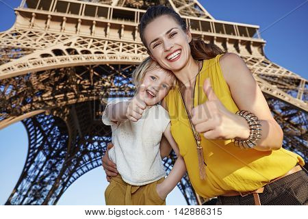 Happy Mother And Daughter Travellers Showing Thumbs Up In Paris