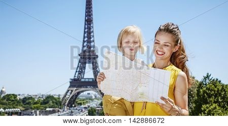 Mother And Child Travellers Exploring Attractions In Paris