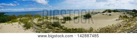 wide panorama view of sand dune and sea