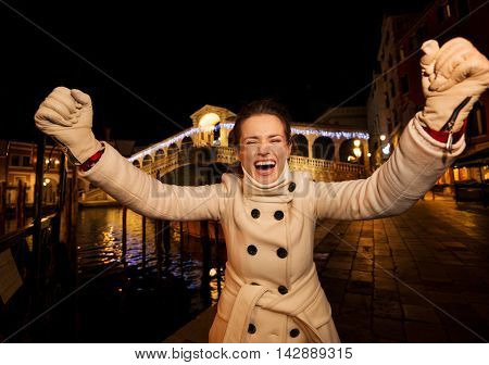 Young Woman Rejoicing Spending Christmas Time In Venice, Italy