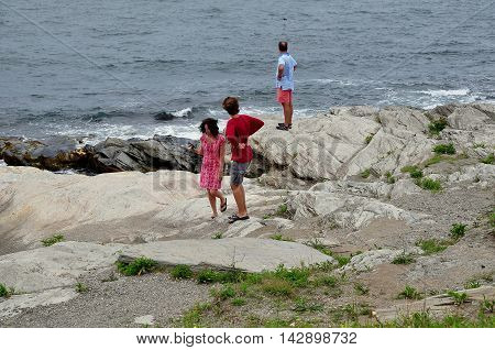 Jamestown Rhode Island: Tourists on the rocky shoreline at Beavertail State Park on Conanicut Island