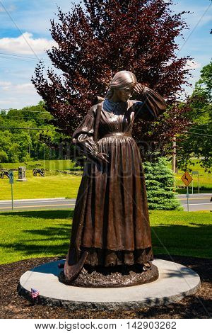 Gettysburg PA - May 16 2010: Statue of caretaker Elizabeth Thorn who despite being pregnant dug soldiers graves at the Evergreen Cemetery following the Battle of Gettysburg.