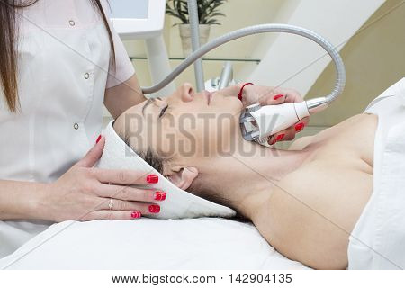 woman is in the process at the clinic lipomassage