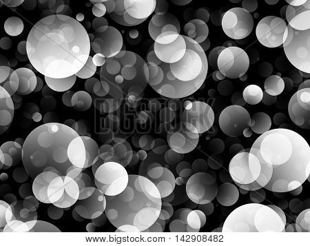 Black and white image of large air bubbles on a dark background.