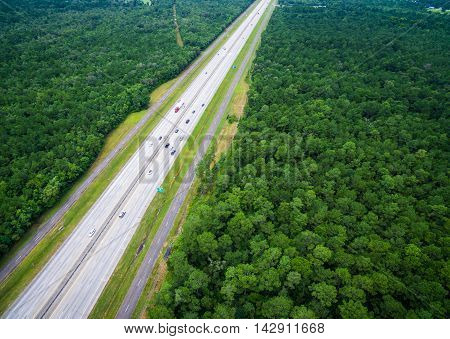 Road Across America Thick Forest Area in North East Texas near Border of Louisiana Aerial View with Major Highway driving across entire Landscape