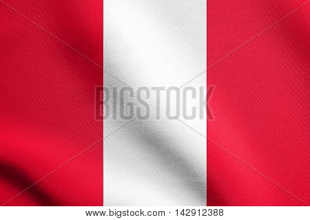 Flag of Peru waving in the wind with detailed fabric texture. Peruvian national flag.