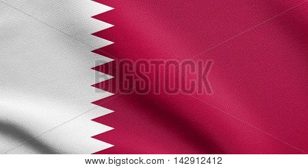 Flag of Qatar waving in the wind with detailed fabric texture. Qatari national flag.