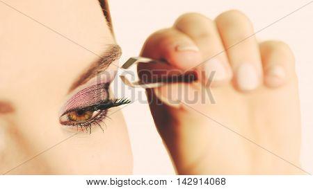 Woman Tweezing Eyebrows Plucking With Tweezers
