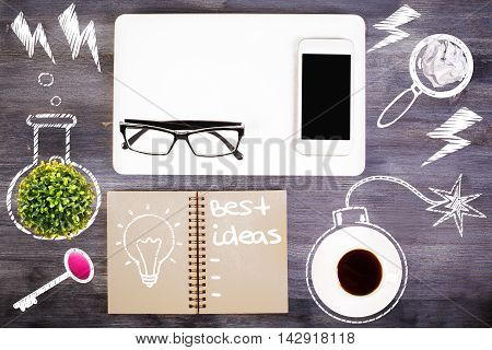 Top view of wooden desktop with coffee cup plant blank smartphone glasses abstract drawings and spiral notepad with lightbulb and 'best ideas' text. Idea concept