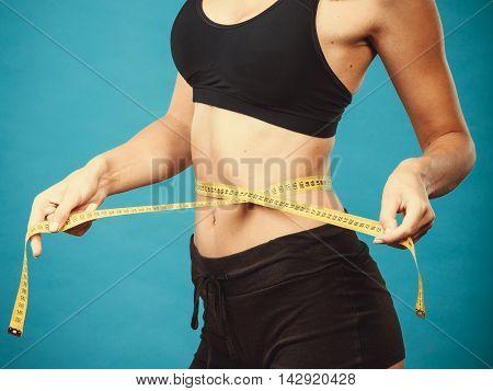Fitness Girl Measuring Her Waistline
