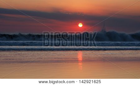 Dramatic sunset on Kuta beach, Bali, Indonesia