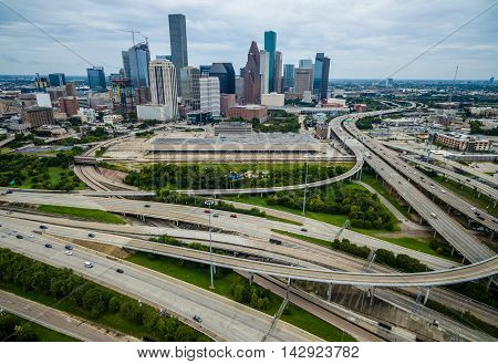 Towers Skyscrapers and Large Downtown Houston Texas Aerial Photography high above Highways and Loops and Interchanges of Urban Sprawl