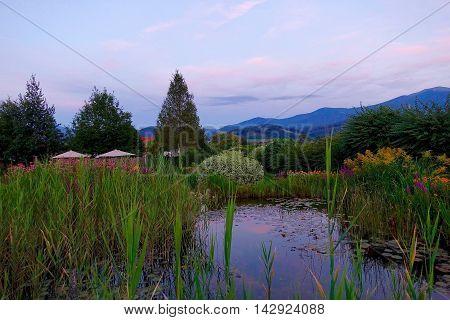 Fisching, Austria, August 3, 2016: A bio pond at sun set in Fisching, Austria.