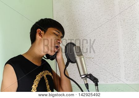 microphone in recording studio microphone condenser handsome man Asian professional musician recording