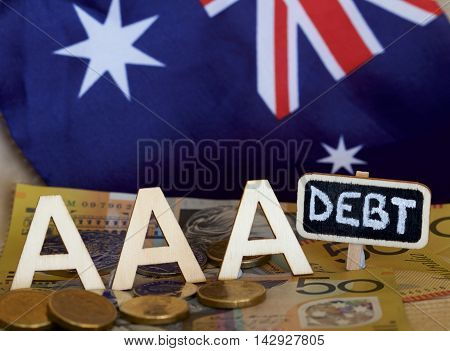 Australian flag with AAA and debt signage.