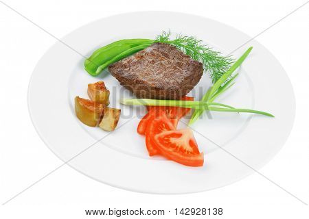 meat food : roasted fillet mignon on white plate with tomatoes apples and chili pepper isolated over white background