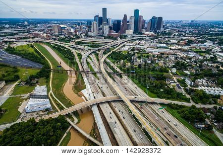 Houston Texas Aerial Urban Sprawl View Over Interstates and Highway , bridges , and loops massive transportation around the huge metropolis of H-Town on a humid