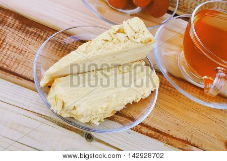 cake dessert and tea on wooden table