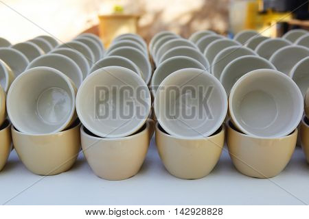 stock coffee cups served on white table as at coffee shop