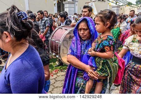 Parramos Guatemala - May 29 2016: Traditionally dressed Mayan women walk alongside Corpus Christi procession.