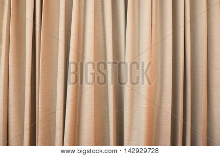 Gold or brown curtain ideal for backgrounds and textures