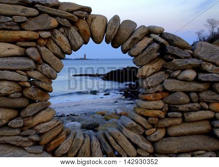 Rock Wall with a window overlooking the ocean.