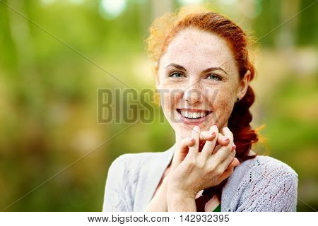 portrait af a beautiful redhead woman outdoors. stylish romantic young girl on a walk in the park. red hair and freckles poster