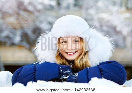 portrait of a funny girl on a walk in the winter. teen outdoors