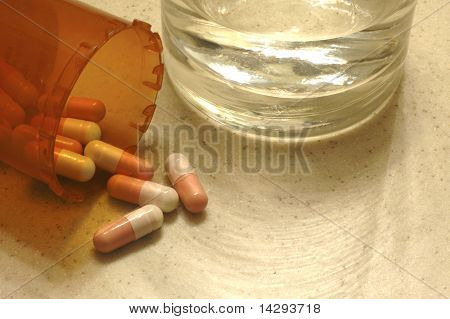 Drug Capsules With A Glass Of Water